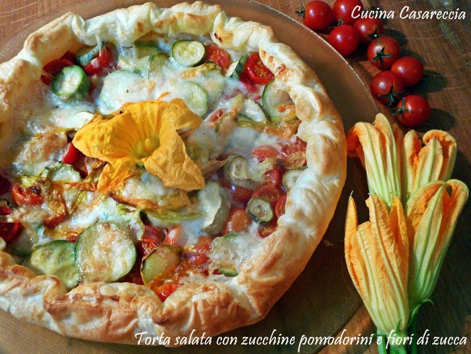 Torta salata con zucchine pomodorini e fiori di zucca